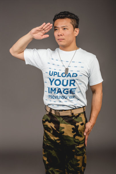 Tshirt Mockup of a Military Man Saluting Against a Gray Background 21261