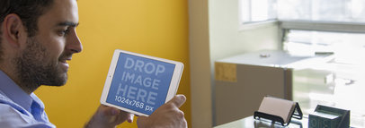 Tablet Mockup Featuring a Young Man at a Creative Office