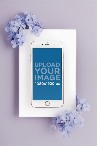 Mockup of an iPhone Lying on a Surface Decorated with Hydrangeas 22137