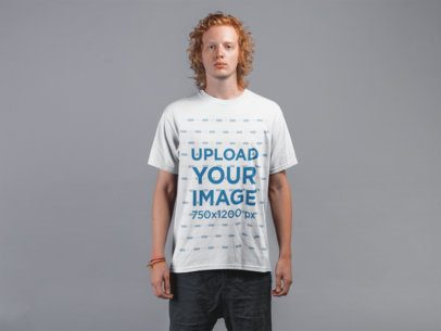 Round Neck Tee Mockup of a Young Man with Red Hair Against Gray Wall 21187