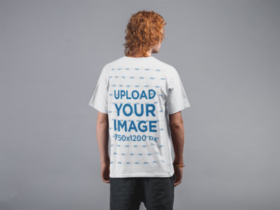 Backshot Mockup of a Man with Red Hair Wearing a T-Shirt Against a Flat Wall 21188