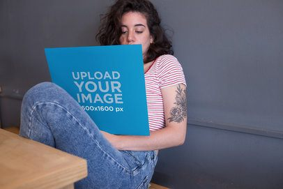 Mockup Featuring a Girl Looking at a Vinyl Record Cover 22102
