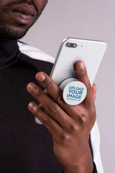 Phone Grip Mockup of a Man with Beard Looking at His Silver iPhone 22155