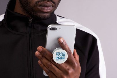 Phone Grip Mockup Featuring a Man Looking at His Smartphone 22156