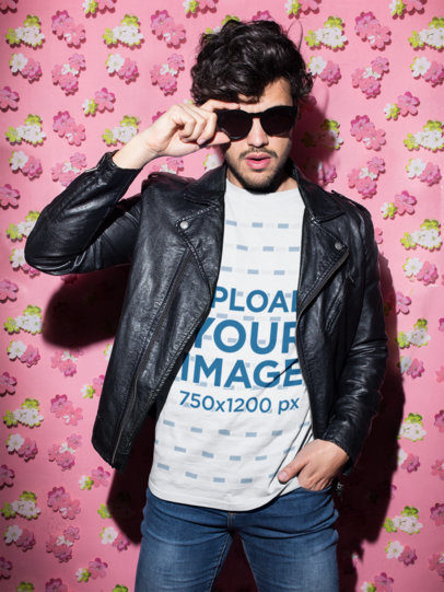 Crewneck Tee Mockup of a Man with a Leather Jacket Against a Pink Wall with a Print of Flowers  18753