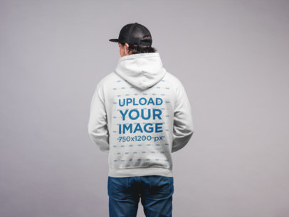 Hoodie Mockup Featuring a Man with a Cap Against a Flat Wall 21657