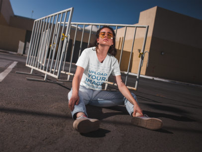 Crewneck Tee Mockup of an Alternative Girl Sitting in an Empty Parking Lot 20041