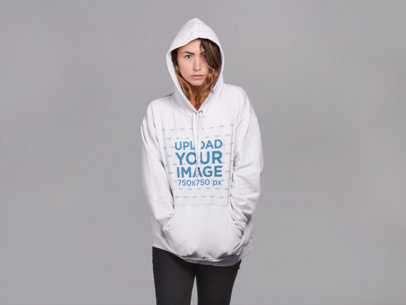 Mockup of a Woman Wearing a Pullover Hoodie with a Serious Look 21307