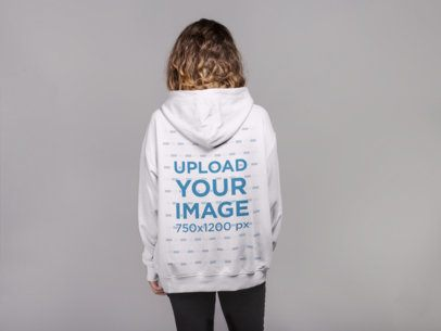 Backshot Pullover Hoodie Mockup Featuring a Curly-Haired Woman 21308