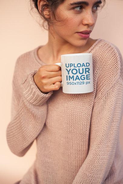 Coffee Mug Mockup Held by a Woman Wearing a Cozy Sweater  22441