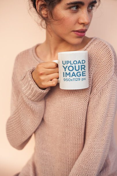 Coffee Mug Mockup Held by a Woman Wearing a Cozy Sweater  22441