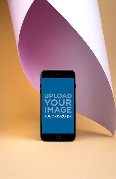 iPhone 8 Plus Mockup Standing Over a Solid Yellow Surface 22195