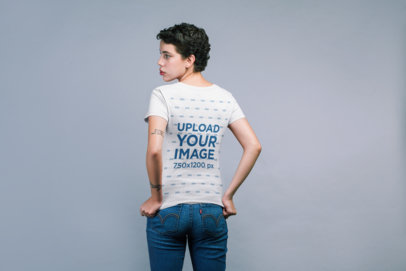Back Shot Mockup of a Woman Wearing a T-Shirt and Pulling it Down 21793