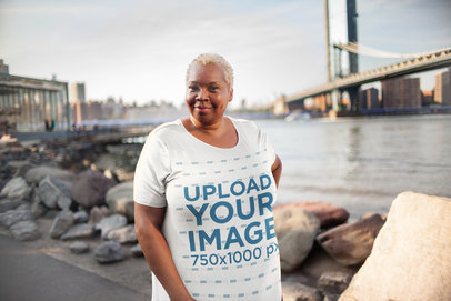 Mockup of a Woman Wearing a Plus Size T-Shirt in a City Setting 22562
