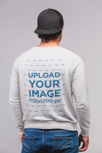 Back View Sweatshirt Mockup Featuring a Man with a Black Cap and Jeans 21722