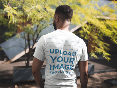 Back View Tshirt Mockup of a Man Facing a House and a Tree 21347