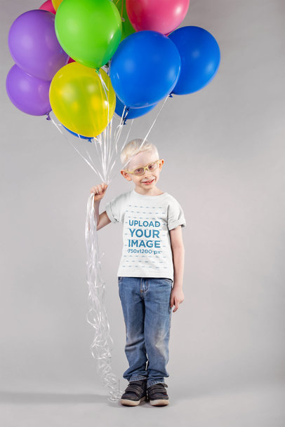Mockup of a Kid Wearing a T-Shirt Holding Balloons 22048