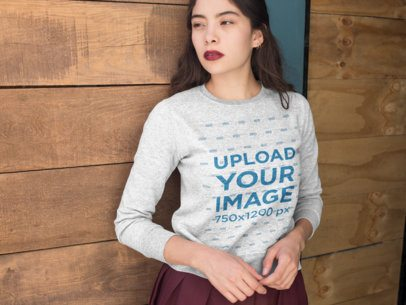 Mockup of a Woman Wearing a Sweatshirt and Looking Into the Distance 18149