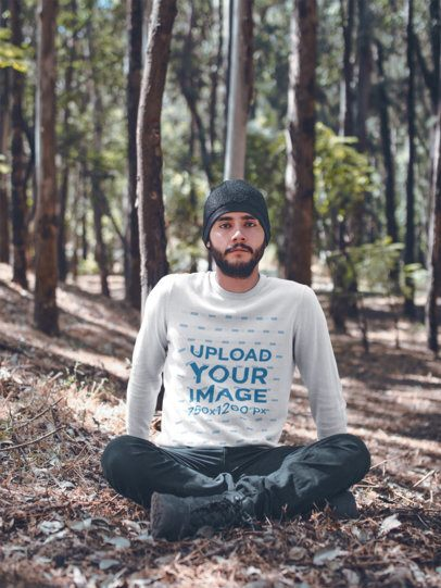 Front View Sweater Mockup of a Man Sitting in the Woods 18091