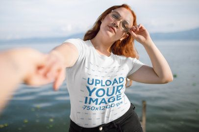 T-Shirt Mockup Featuring a Woman on a Dock Holding Someone's Hand 21939