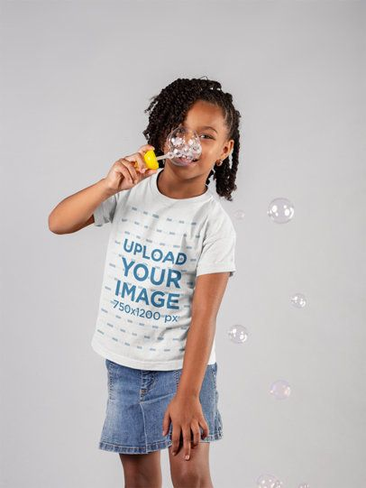 T-Shirt Mockup of a Little Girl Blowing Bubbles in a Studio 22060