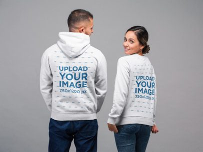 Pullover Hoodie and Sweatshirt Mockup Featuring a Man and a Woman 22354