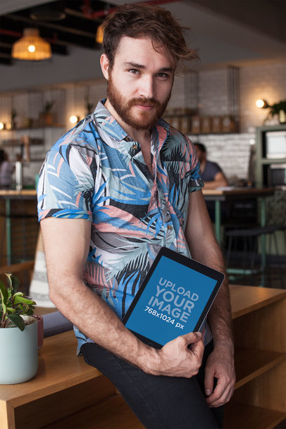 iPad Mockup Held by a Man Wearing a Colorful Shirt 22599