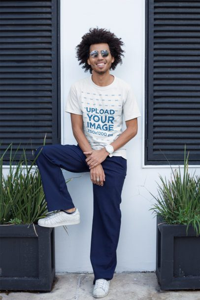 T-Shirt Mockup of a Smiling Guy with an Afro Wearing Sunglasses 22256