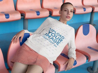 Sweater Mockup Featuring a Girl Posing Over Stadium Seats 18412