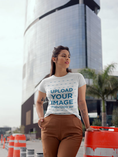 Round Neck Tee Mockup of a Girl Near a Big Modern Building 22681