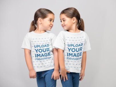 Mockup of Two Little Girls Wearing Tshirts in a Photo Studio 22518