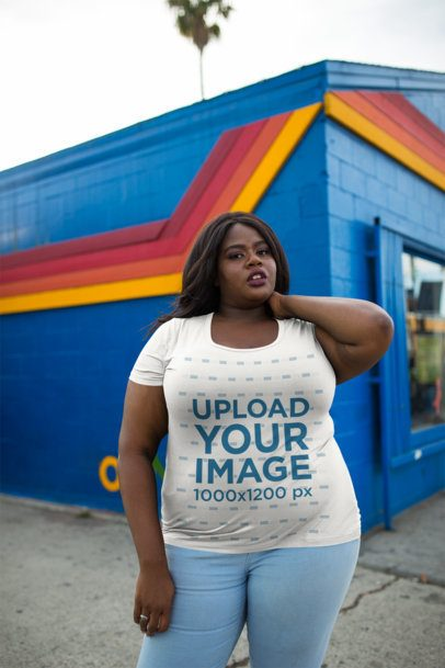 Plus Size Round Neck T-Shirt Mockup Featuring a Woman Outside a Blue and Orange Store 18295