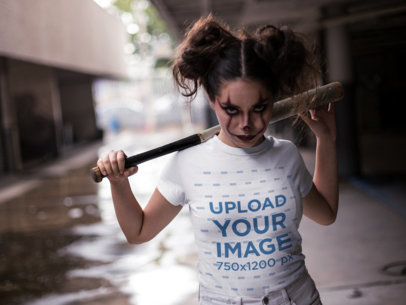 T-Shirt Mockup of a Woman Wearing Halloween Makeup and Staring at the Camera 22925