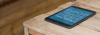 Mockup of a Black iPad Mini at a Wood Workshop a3136