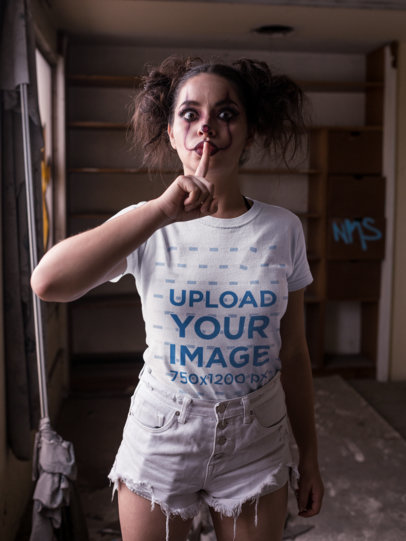 Mockup of a Woman Wearing a T-Shirt and Holding Her Finger to Her Lips 22935