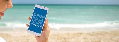 Android Mockup Featuring a Young Lady at the Beach a3214