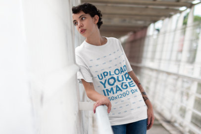 T-Shirt Mockup of a Woman Looking Out from a Pedestrian Bridge 22746