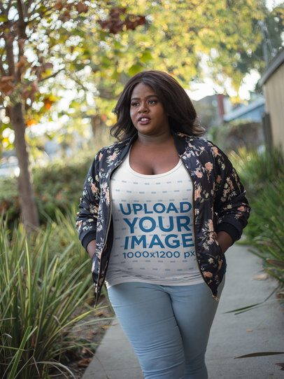 Plus Size T-Shirt Mockup Featuring a Woman Wearing a Bomber Jacket 18299