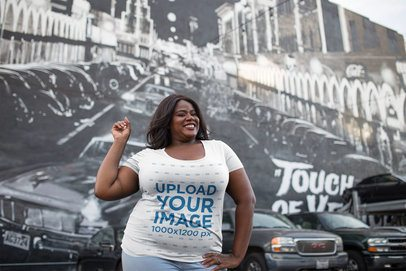 Plus Size T-Shirt Mockup of Happy Woman Against a Venice Beach Wall Mural 18300