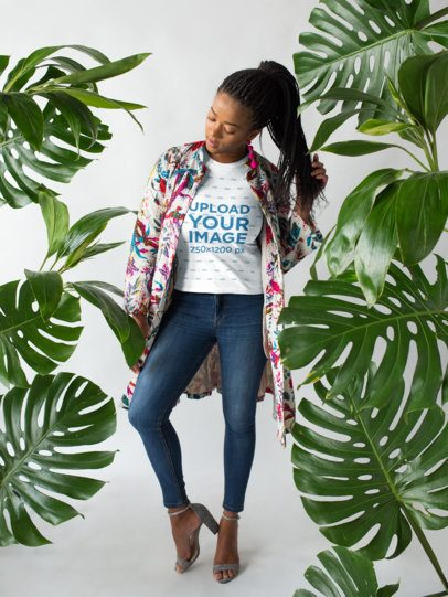 T-Shirt Mockup of a Trendy Woman Wearing Silver Heels and Posing  18370