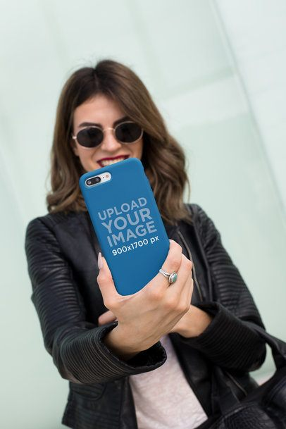 Mockup of a Phone Case Held By a Woman Wearing a Leather Jacket 22896