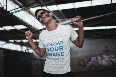 Tshirt Mockup Featuring a Man with Skull Makeup and a Baseball Bat Against his Back 23023
