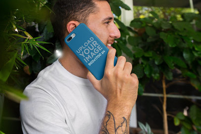 Mockup of a Phone Case Held Up to a Man's Ear 22878