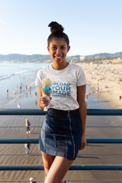 T-Shirt Mockup of a Happy Girl with an Ice Cream at a Beach Pier 18213