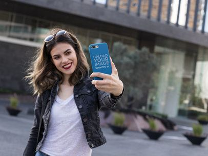 iPhone Case Mockup Featuring a Woman Taking a Cool Selfie 22904