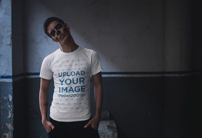 T-Shirt Mockup of a Man with Skull Makeup Against a Wasted Wall 23028