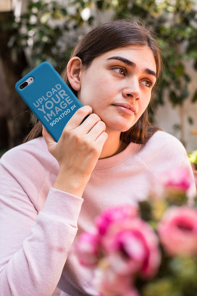 Mockup of a Girl Holding a Phone Case Near Flowers 22892