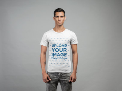 Mockup of a Serious Tattooed Man Wearing a T-Shirt in a Studio 21550