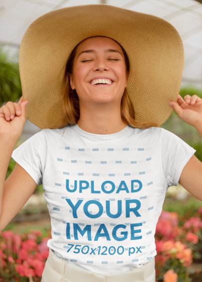 T-Shirt Mockup of a Happy Woman Wearing a Large Sun Hat 22504