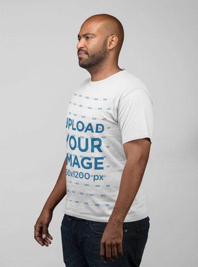 T-Shirt Side View Mockup of a Man at a Studio 21692